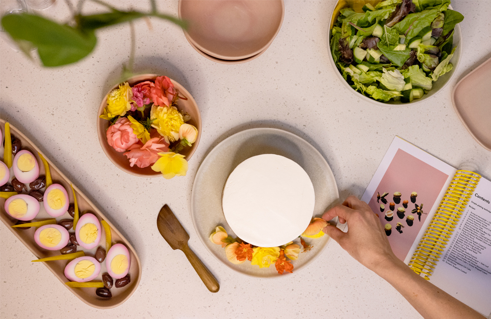 arranging edible flowers on a kitchen counter