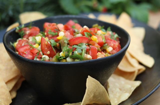 fire roasted salsa in a black bowl