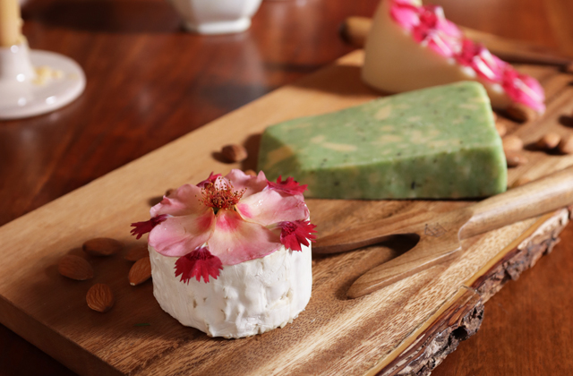 edible flowers arranged on cheese